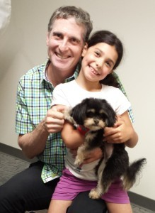 Dr Brian and his daughter with dog