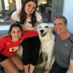 Dr. Brian and his daughters with Roxy who they rescued.